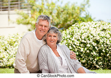 Retired couple looking at the camera