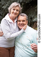 Retired couple - Portrait of a happy retired couple against ...