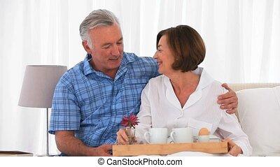 Retired couple preparing the breakfast