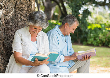 Retired couple reading books together
