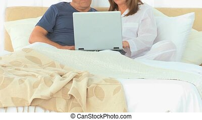 Retired couple using a laptop together