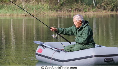 Retired fisherman fishing on the lake