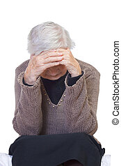Retired life - Elderly wrinkled woman sitting lonely on the...