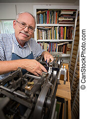 Retired man in workshop - Happy Retired Man working on a ...