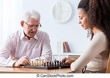 Retired man playing chess