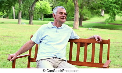 Retired man relaxing on a park bench