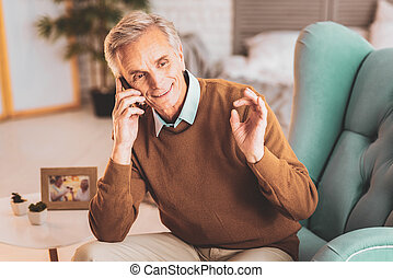 Retired man talking to his business partners on the phone