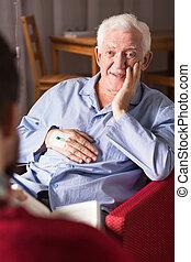 Retired man wtih carergiver