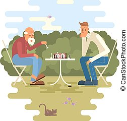 men playing chess - Retired men playing chess in a park. ...