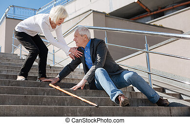 Retired pensioner resting on the stairs on the promenade
