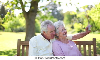 Retired people in love taking a picture together