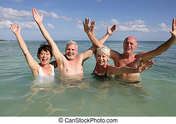 Retired people swimming in the ocean