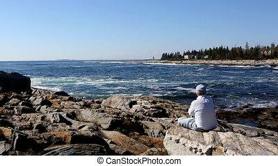 Retired Senior Adult Watching Surf Maine Coastline