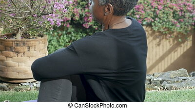 Retired senior African American woman doing half spinal...