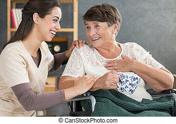 Retired woman drinking tea