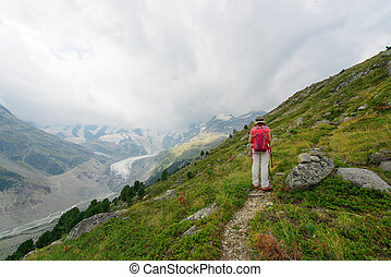 Retired woman During a walk in the high mountains