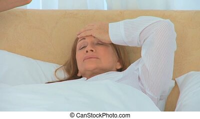 Retired woman feeling bad in her bed