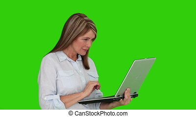 Retired woman holding a laptop