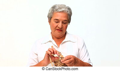 Retired woman knitting
