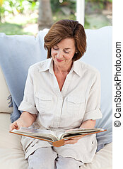 Retired woman reading her book