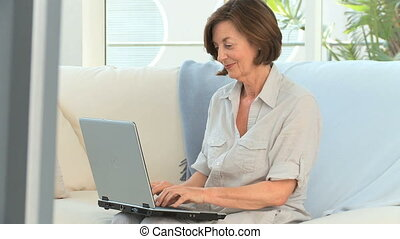 Retired woman working on a computer