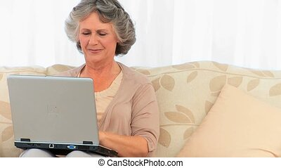 Retired woman working on her laptop