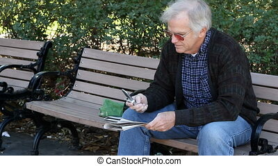 Retiree Calling About Ads - Retired man, sitting on a park...