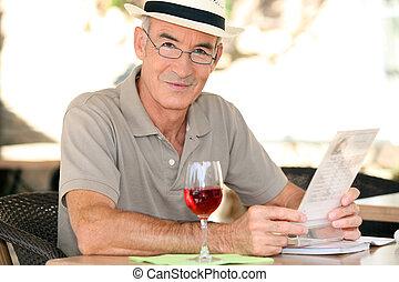 Retiree enjoying a glass of wine