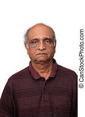 Retirement - an old indian senior loking very sad about his...