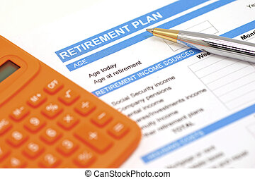 retirement plan document with pen and orange calculator