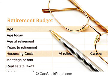 retirement plan document with pen and eye glasses