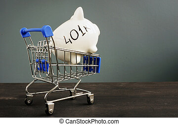 Retirement plan. Piggy bank with 401k in the shopping cart.