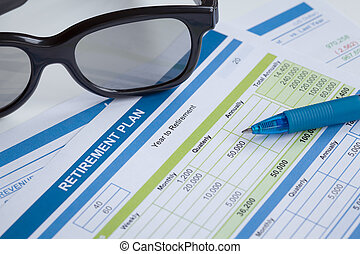 Retirement Planning with glasses and pen, business concept