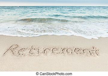 Retirement written on sand by sea at beach