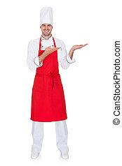 retrato, de, alegre, cozinheiro, em, uniforme, apresentando