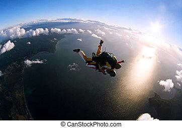 retrato, de, dos, skydivers, en acción