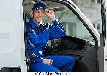 retrato, de, feliz, técnico, sentado, en, furgoneta