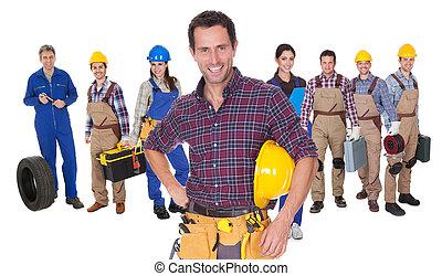 retrato, de, feliz, trabajadores industriales