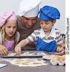 retrato, de, padre y niños, hornada, en la cocina