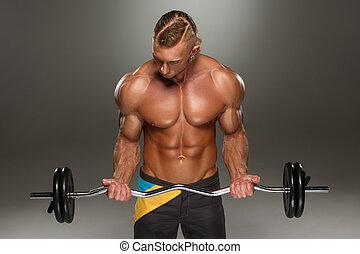 retrato, de, súper, ataque, muscular, joven, cálculo, en, gym.