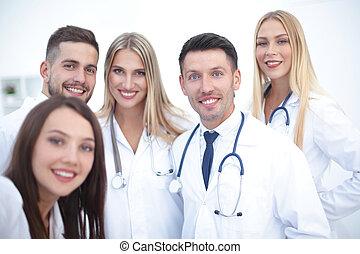 retrato, de, sonriente, equipo médico