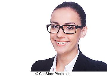 retrato, de, success., alegre, mulher jovem, em, formalwear, e, óculos, olhando câmera, e, sorrindo, enquanto, ficar, isolado, branco