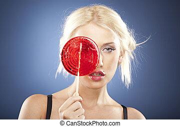 retrato, de, um, bonito, loiro, com, um, lollipop.