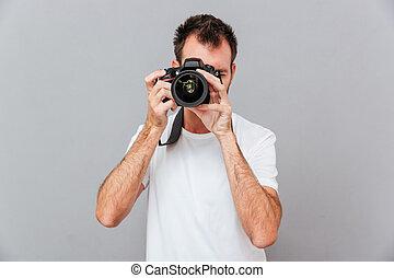 retrato, de, um, jovem, fotógrafo, com, câmera