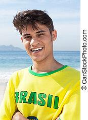 retrato, de, un, brasileño, ventilador deportivo, en, playa