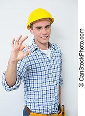 retrato, de, un, factótum, en, sombrero duro amarillo, el gesticular, muestra aceptable