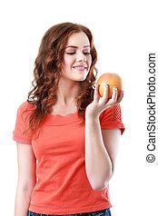 retrato, de, un, joven, mujer hermosa, con, naranja