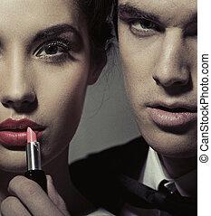 retrato, de, un, mujer y hombre, con, lápiz labial