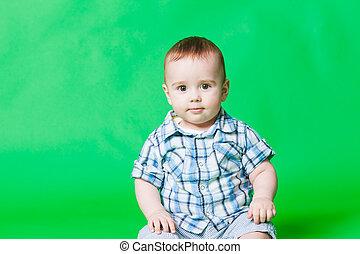 retrato, de, un, pequeño, bebé, niño, mirar la cámara