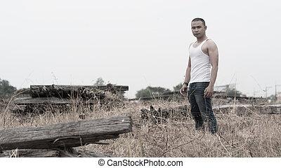 retrato, macho asiático, modelo, en, pradera, vendimia, estilo